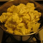 Steam the cauliflower until fork tender